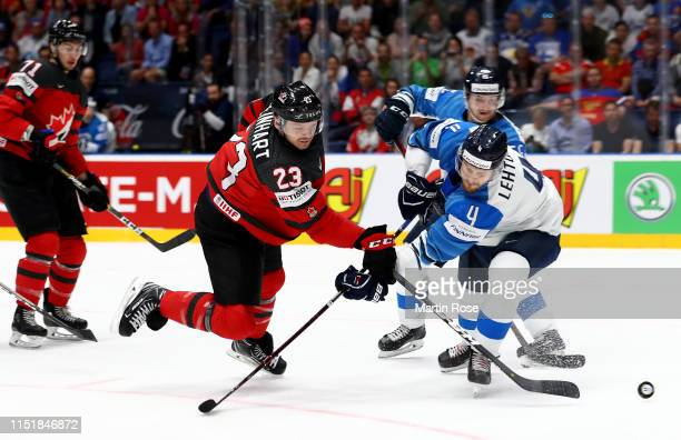 Sam Reinhart of Canada challenges Mikko Lehtonen of Finland during the 2019 IIHF Ice Hockey World Championship Slovakia final game between Canada and...