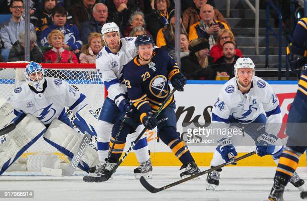 Sam Reinhart of the Buffalo Sabres and Dan Girardi of the Tampa Bay Lightning battle for position in front of Louis Domingue of the Tampa Bay...