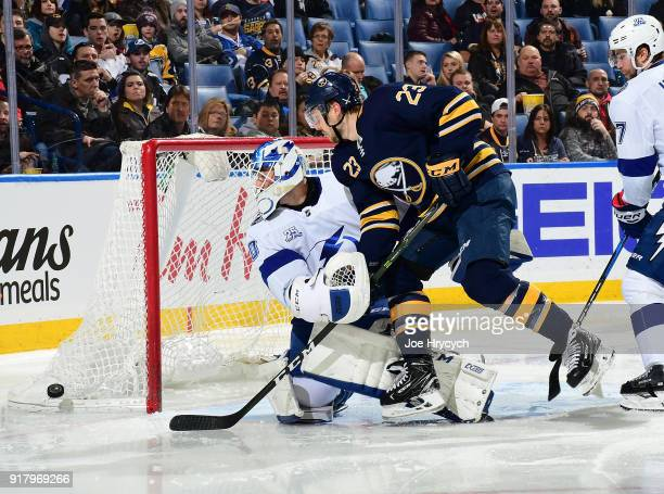 Sam Reinhart of the Buffalo Sabres battles for the puck against Louis Domingue of the Tampa Bay Lightning during an NHL game on February 13 2018 at...