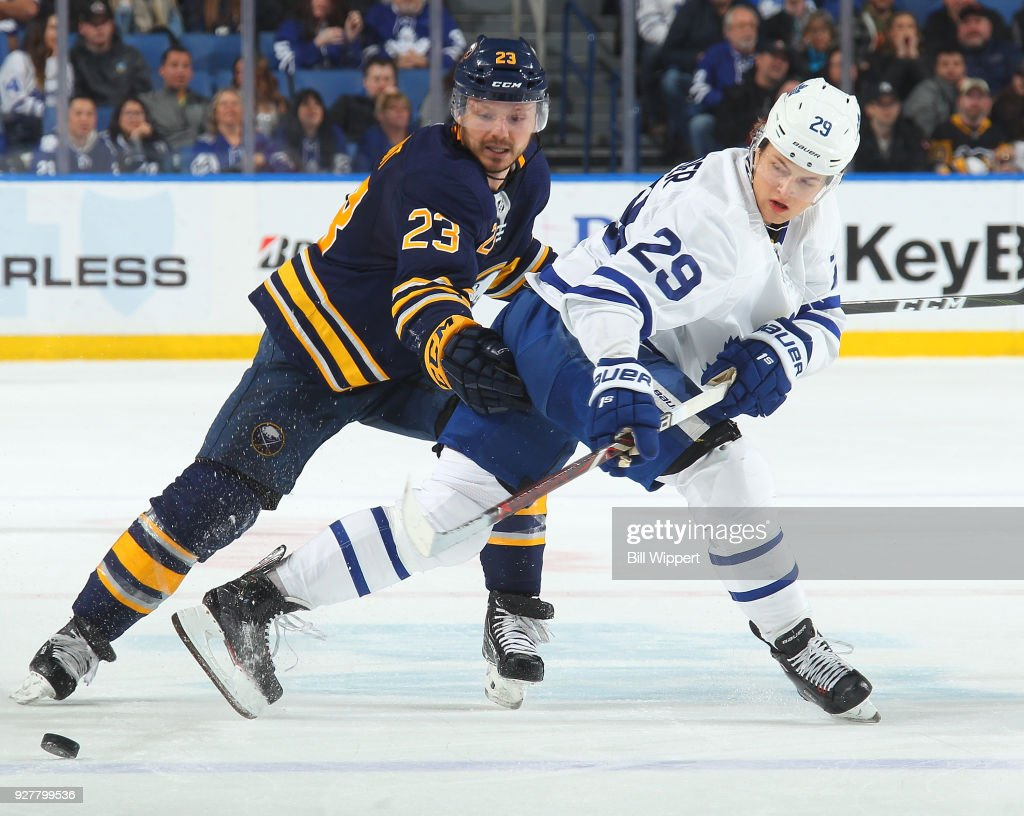 Sam Reinhart #23 of the Buffalo Sabres battles for the puck against William Nylander #29 of the Toronto Maple Leafs during an NHL game on March 5, 2018 at KeyBank Center in Buffalo, New York. Buffalo won, 5-3.