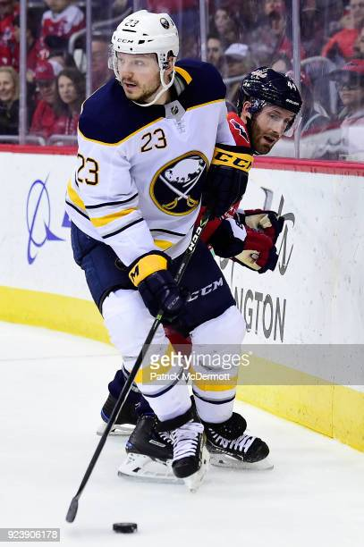 Sam Reinhart of the Buffalo Sabres controls the puck against Brooks Orpik of the Washington Capitals in the second period at Capital One Arena on...
