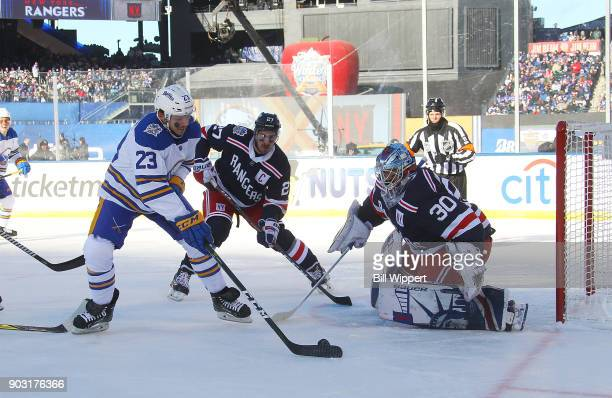 Sam Reinhart of the Buffalo Sabres controls the puck against Henrik Lundqvist of the New York Rangers during the 2018 Bridgestone NHL Winter Classic...