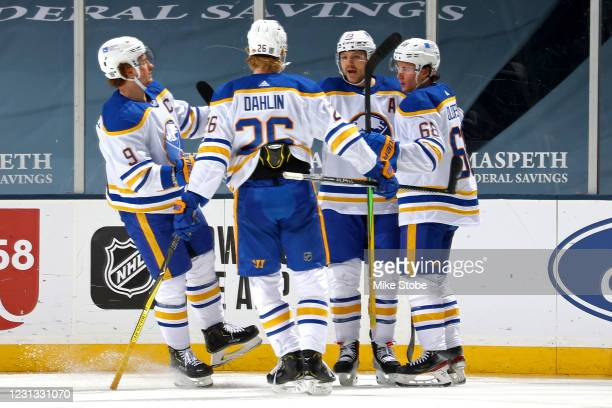 Sam Reinhart of the Buffalo Sabres is congratulated by his teammates after scoring a goal against the New York Islanders during the third period at...
