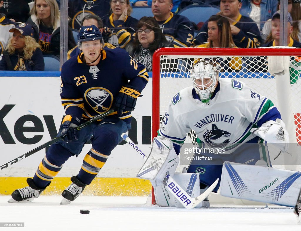 Sam Reinhart #23 of the Buffalo Sabres looks for a pass as Jacob Markstrom #25 of the Vancouver Canucks tends net during the third period at the KeyBank Center on October 20, 2017 in Buffalo, New York. Canucks beat the Sabres 4-2.