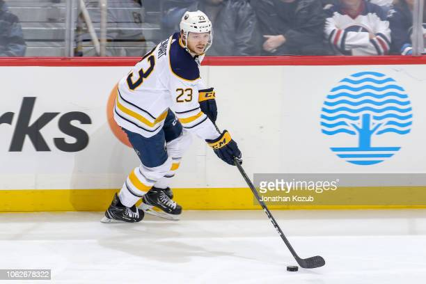 Sam Reinhart of the Buffalo Sabres plays the puck up the ice during second period action against the Winnipeg Jets at the Bell MTS Place on November...
