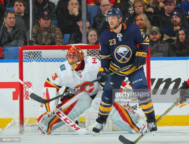 Sam Reinhart of the Buffalo Sabres screens goaltender David Rittich of the Calgary Flames during an NHL game on March 7 2018 at KeyBank Center in...
