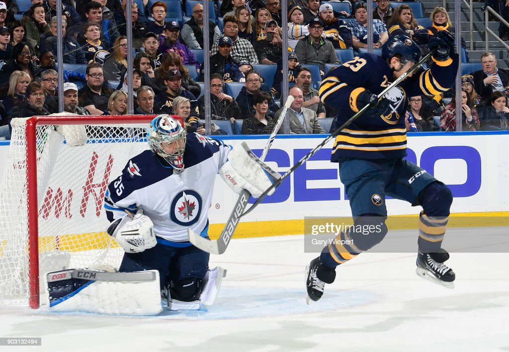 Sam Reinhart #23 of the Buffalo Sabres screens Steve Mason #35 of the Winnipeg Jets during an NHL game on January 9, 2018 at KeyBank Center in Buffalo, New York.