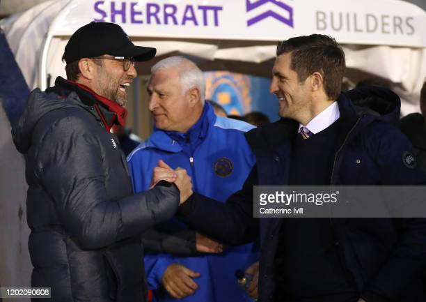 Sam Ricketts Manager of Shrewsbury Town shakes hands with Jurgen Klopp Manager of Liverpool during the FA Cup Fourth Round match between Shrewsbury...