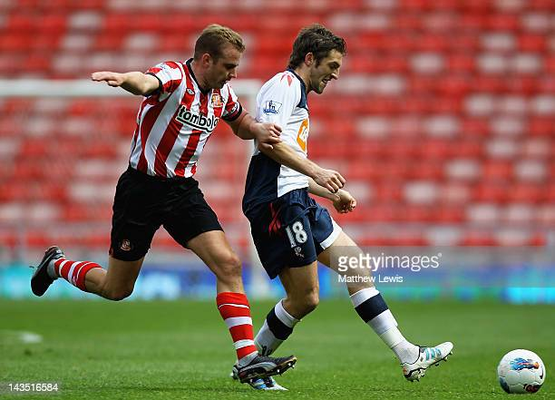 Sam Ricketts of Bolton holds off Lee Cattermole of Sunderland during the Barclays Premier League match between Sunderland and Bolton Wanderers at...