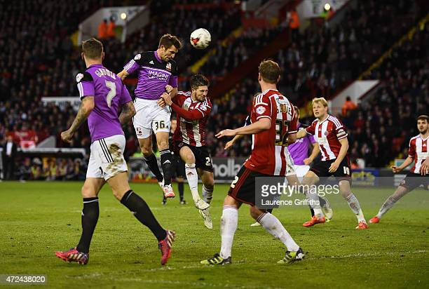 Sam Ricketts of Swindon Town scores the equalising goal during the Sky Bet League One playoff semi final match between Sheffield United and Swindon...