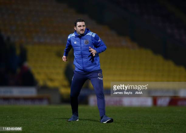 Sam Ricketts the head coach / manager of Shrewsbury Town celebrates winning the game at full time after the FA Cup First Round Replay match between...