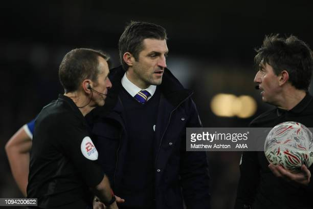 Sam Ricketts the head coach / manager of Shrewsbury Town chats to the officials at the end of the game and later came out berating VAR where he...