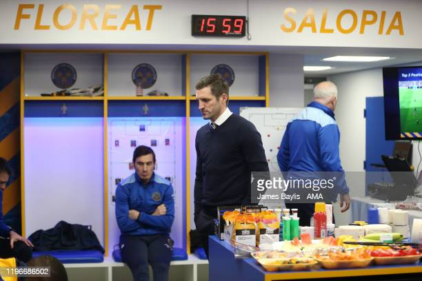 Sam Ricketts the Shrewsbury Town head coach / manager gives his half time team talk in the home dressing room during the FA Cup Fourth Round match...