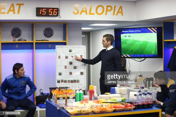 Sam Ricketts the Shrewsbury Town manager gives his half time team talk in the home dressing room during the FA Cup Fourth Round match between...