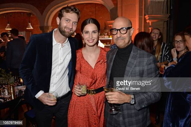 Sam Ritzenberg Heida Reed and Stanley Tucci attend the unveiling of Johnnie Walker Blue Label Ghost and Rare Port Ellen at The Welsh Chapel on...