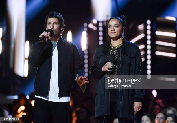 Sam Roberts and Tasha the Amazon present award at the 2017 Juno Awards at The Canadian Tire Centre on April 2 2017 in Ottawa Canada