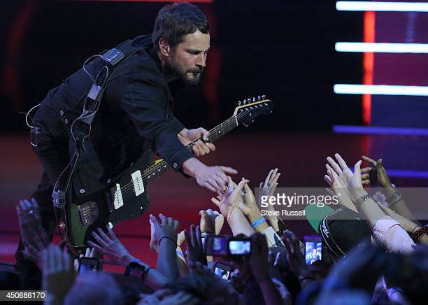 TORONTO JUNE 15 Sam Roberts gets some high fives front he crowd during this set at the MMVA 2014 awards show featuring some of the countries best...