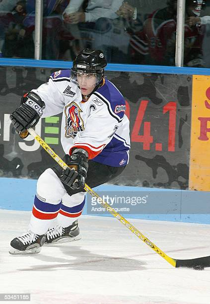 Sam Roberts of Gatineau Olympiques looks make a pass play against the Halifax Mooseheads during the Quebec Major Junior Hockey League game at...