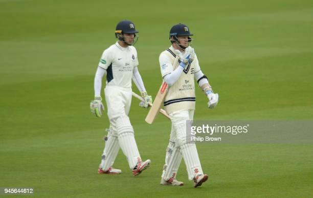 Sam Robson and Max Holden of Middlesex come out to bat before day one of the Specsavers County Championship Division Two cricket match between...