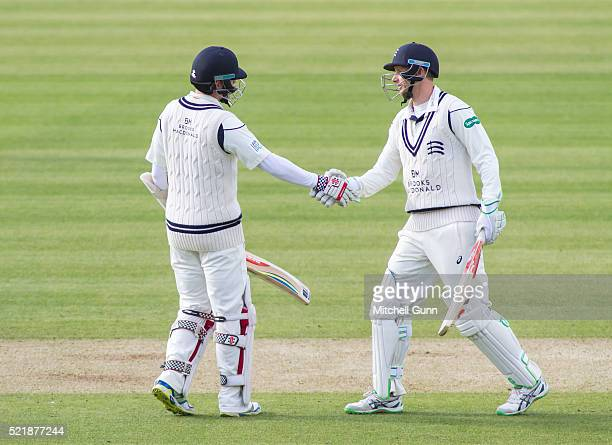 Sam Robson of Middlesex celebrates scoring 150 runs with captain Adam Voges during the Specsavers County Championship match between Middlesex and...