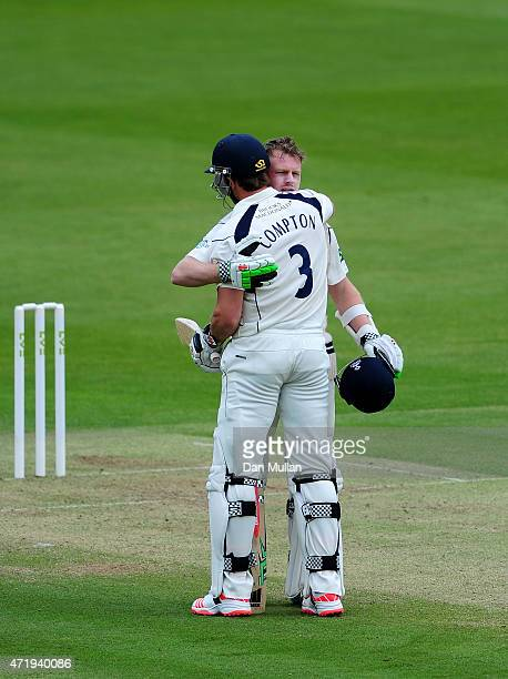 Sam Robson of Middlesex embraces Nick Compton of Middlesex after reaching his century during day one of the LV County Championship match between...