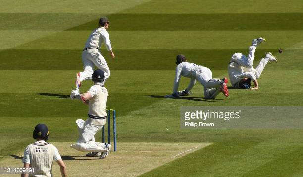 Sam Robson of Middlesex gets the ball past Ollie Pope and Ben Foakes of Surrey during day two of the LV= Insurance County Championship match between...