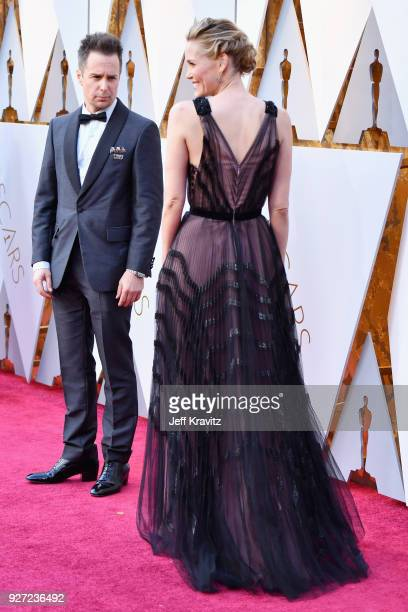 Sam Rockwell and Leslie Bibb attend the 90th Annual Academy Awards at Hollywood Highland Center on March 4 2018 in Hollywood California