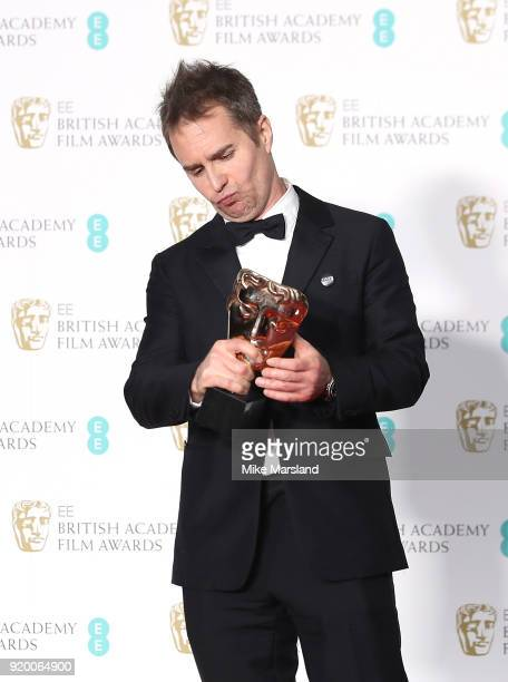 Sam Rockwell winner of the Best Supporting Actor award for the movie 'Three Billboards Outside Ebbing Missouri' poses in the press room during the EE...