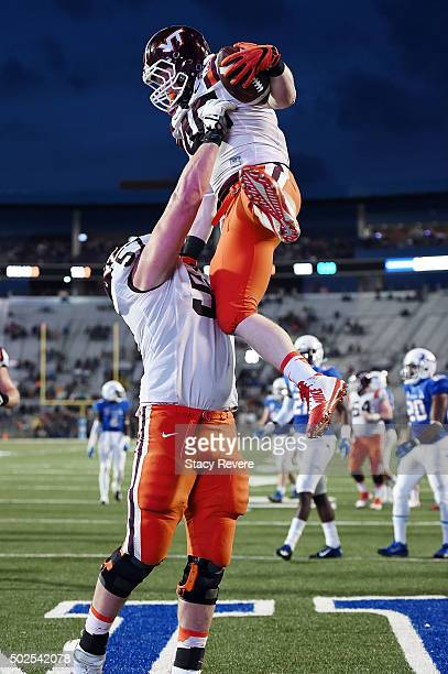 Sam Rogers of the Virginia Tech Hokies celebrates a touchdown with Wyatt Teller during the first half of the Camping World Independence Bowl against...