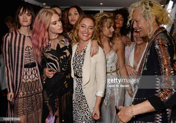 Sam Rollinson Mary Charteris Olga Kurylenko Alice Temperley Alice Dellal Nathalie Emmanuel Helen McCrory and Ellen von Unwerth pose backstage at the...