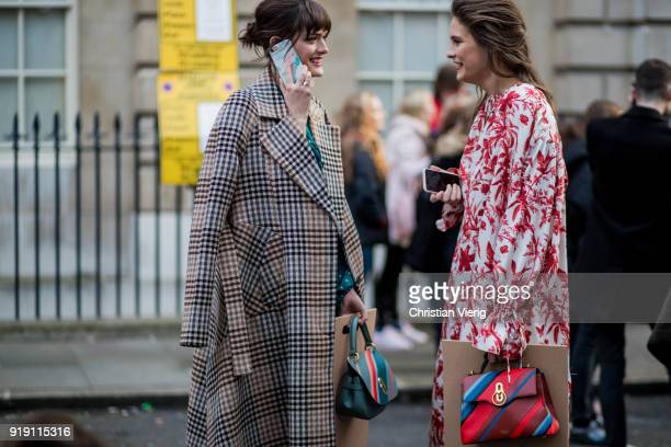 Sam Rollinson wearing plaid coat Mulberry bag and Charlotte Wiggins wearing red white dress seen outside Mulberry during London Fashion Week February...