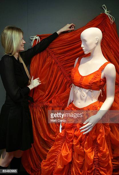 Sam Rowe models a Norma Kamali skirt and bustier estimated at 10002000 GBP at a preview or Christie's Resurrection Avant Garde Fashion auction on...