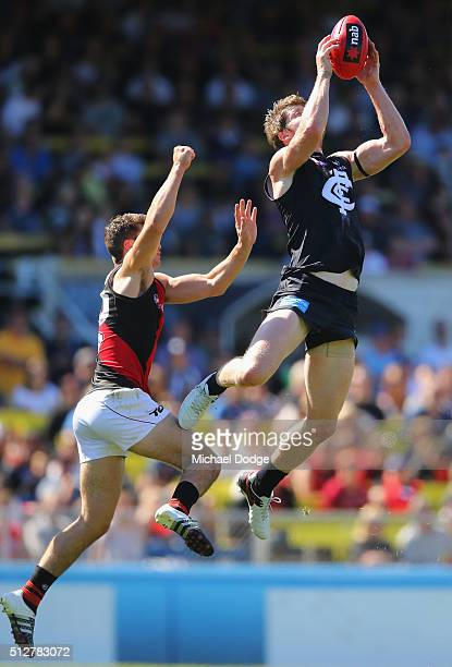 Sam Rowe of the Blues marks the ball during the 2016 AFL NAB Challenge match between Carlton and Essendon at Ikon Park on February 28 2016 in...