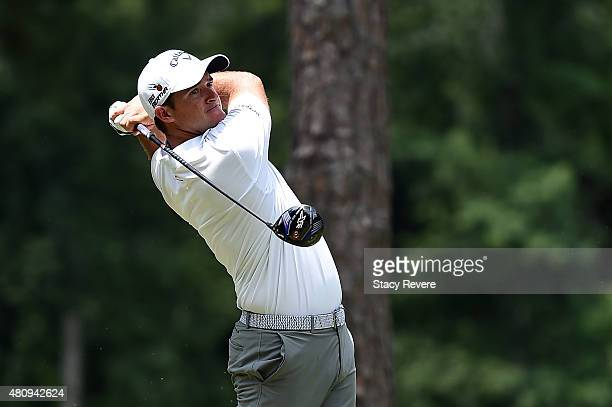 Sam Saunders of the United States hits his tee shot on the fifth hole during the first round of the Barbasol Championship at the Robert Trent Jones...