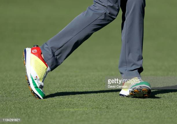 Sam Saunders of the United States wears a pair of shoes to commemorate his grandfather Arnold Palmer as he plays his second shot on the par 4 18th...
