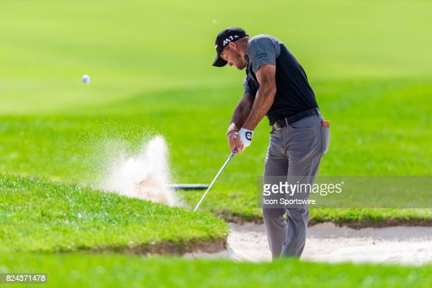 Sam Saunders plays a shot out of a sand trap on the 18th hole during third round action of the RBC Canadian Open on July 29 at Glen Abbey Golf Club...