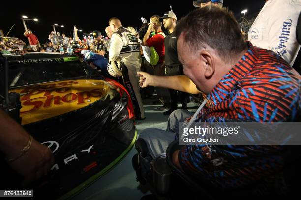 Sam Schmidt celebrates after Martin Truex Jr driver of the Bass Pro Shops/Tracker Boats Toyota won the Monster Energy NASCAR Cup Series Championship...