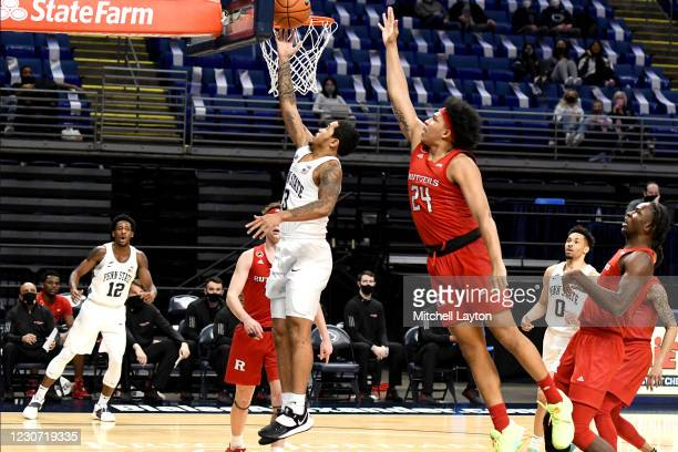Sam Sessoms of the Penn State Nittany Lions drives to the basket past Ron Harper Jr. #24 of the Rutgers Scarlet Knights in the first half during a...