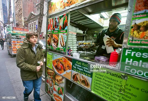Sam Sevian of Southbridge Mass the youngestever American born grandmaster grabs a quick lunch from a NYC food truck during his 'Young Stars Team USA'...