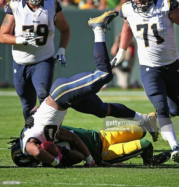 Sam Shields of the Green Bay Packers brings down Todd Gurley of the St Louis Rams at Lambeau Field on October 11 2015 in Green Bay Wisconsin The...