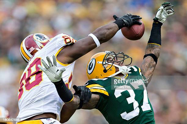 Sam Shields of the Green Bay Packers goes up for a interception but has the ball knocked away by Pierre Garcon of the Washington Redskins at Lambeau...