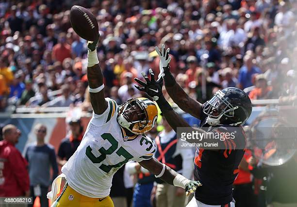 Sam Shields of the Green Bay Packers tips the football away from Alshon Jeffery of the Chicago Bears in the first half at Soldier Field on September...