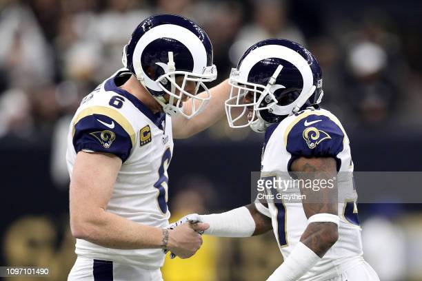 Sam Shields of the Los Angeles Rams celebrates with Johnny Hekker after scoring a first down on a fake punt against the New Orleans Saints during the...