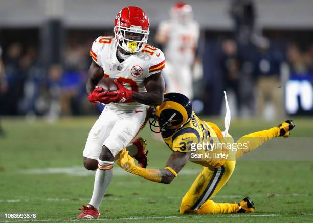 Sam Shields of the Los Angeles Rams falls after Tyreek Hill of the Kansas City Chiefs makes a reception during the second quarter of the game at Los...