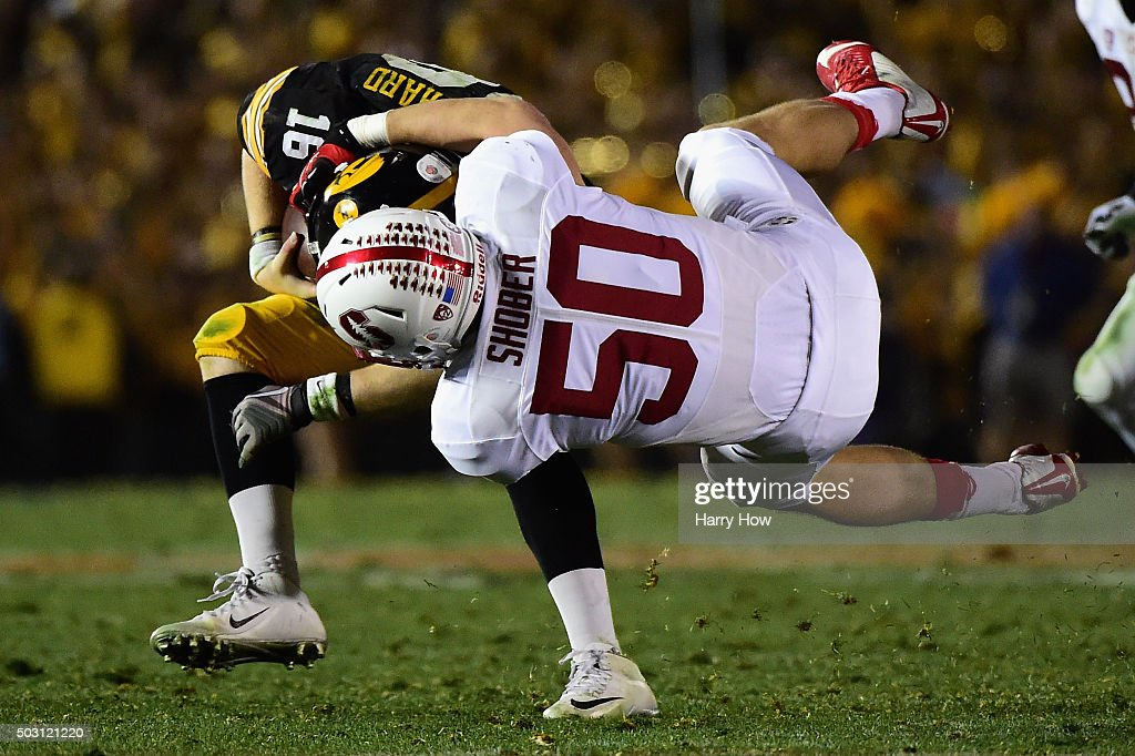 Sam Shober #50 of the Stanford Cardinal tackles quarterback C.J. Beathard #16 of the Iowa Hawkeyes in the 102nd Rose Bowl Game on January 1, 2016 at the Rose Bowl in Pasadena, California.