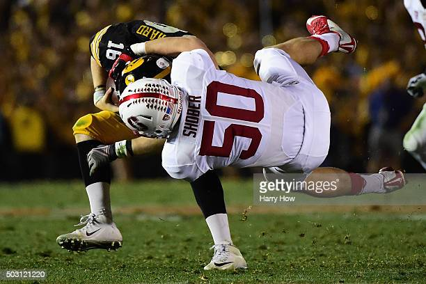 Sam Shober of the Stanford Cardinal tackles quarterback CJ Beathard of the Iowa Hawkeyes in the 102nd Rose Bowl Game on January 1 2016 at the Rose...