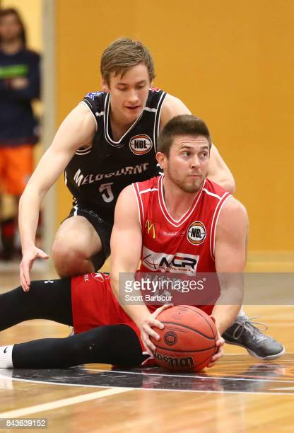 Sam Short of Melbourne United and Rotnei Clarke of the Hawks compete for the ball during the 2017 NBL Blitz preseason match between Melbourne United...