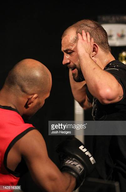 Sam Sicilia absorbs punches to the stomach by assistant coach Wilson Reis during a Team Cruz training session during season fifteen of The Ultimate...