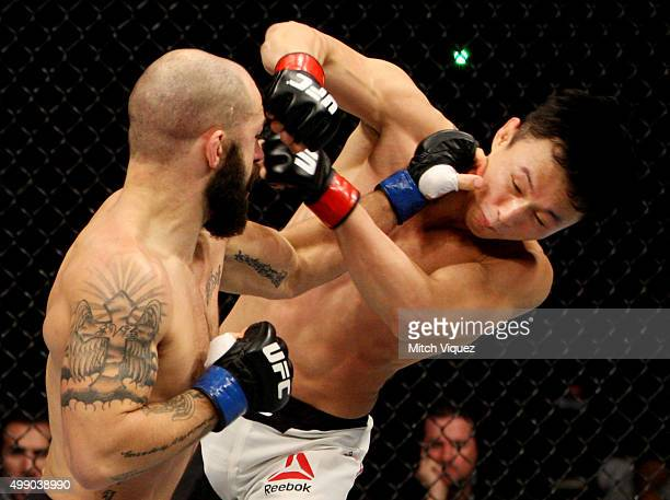 Sam Sicilia of the United States of America punches Doo Ho Choi of South Korea in their featherweight bout during the UFC Fight Night at the Olympic...