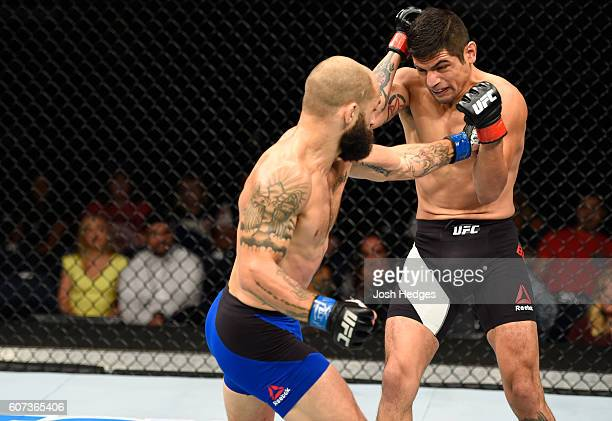 Sam Sicilia punches Gabriel Benitez of Mexico in their featherweight bout during the UFC Fight Night event at State Farm Arena on September 17 2016...